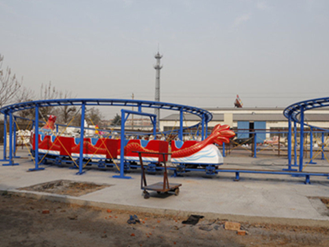 Red dragon roller coaster with double track
