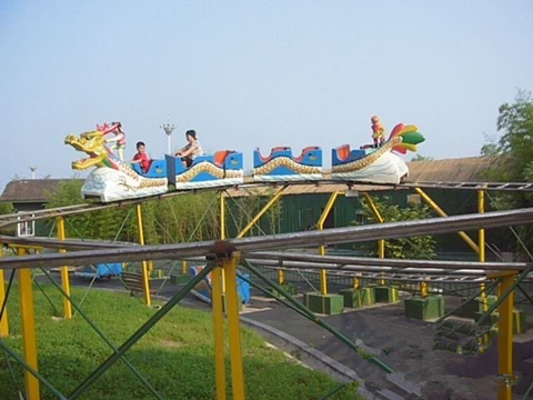 Yellow dragon roller coaster ride